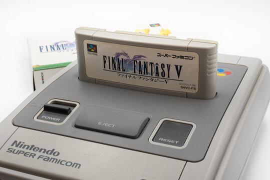 Fukuoka, Japan - may 1, 2019 : the famous squaresoft 1990's hit final fantasy V cartridge plugged into the original Nintendo Super Famicom