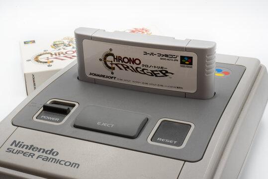 Fukuoka, Japan - may 1, 2019 : the famous squaresoft 1990's game Chrono trigger cartridge plugged into the original Nintendo Super Famicom