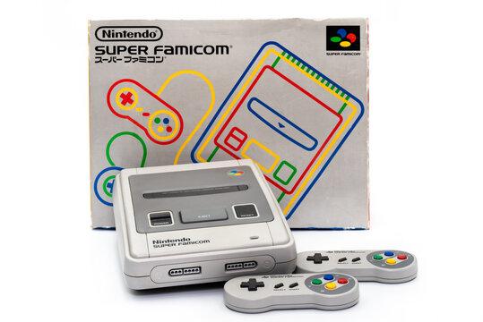 Fukuoka, Japan - may 1, 2019 : the famous 1990's Nintendo 16-bit entertainment system Super Famicom isolated on white background with the original box