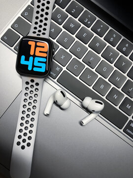 New Apple AirPods Pro with Apple Watch series 4 with white Nike Sport Band on the MacBook Pro. 01.12.2019 Kemalpasa, Izmir, Turkey.