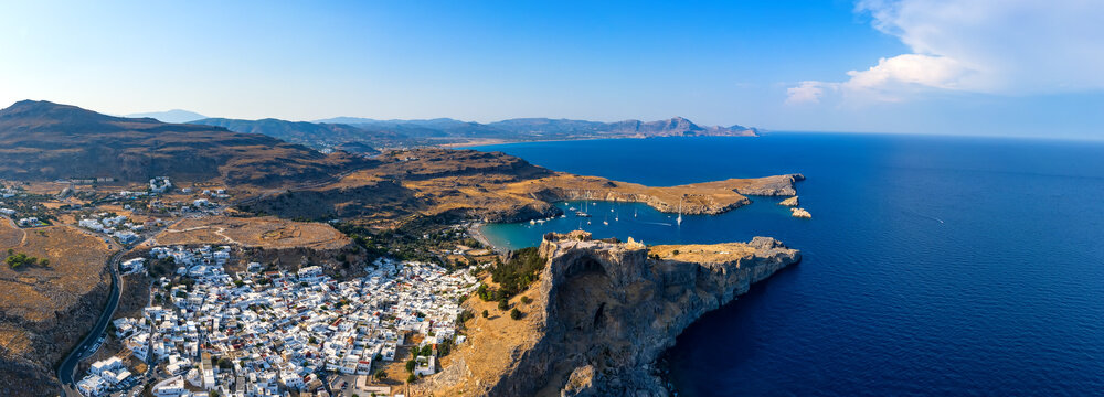 panorama of sea and the Bay of the Acropolis of Lindos with the village, Rhodes island, Greece
