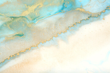 Art Abstract blue and gold painting blots landscape background. Alcohol ink colors. Marble texture.