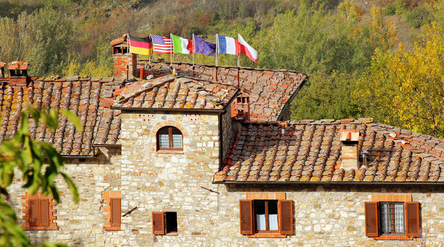 Villa in Rada, Tuscany, Italy with six national flags on roof