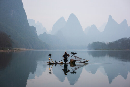 Chinese traditional fisherman with cormorants fishing, Li River