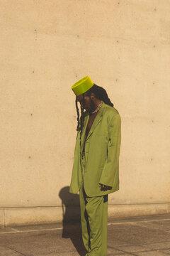 Black Man Wearing A Green Suit