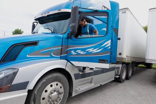 Trucker leaving container semi truck