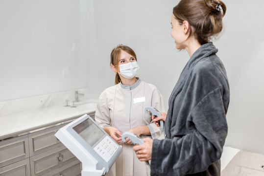 Woman measuring body composition balance, standing with a medical assistant on the scales during Inbody test at the luxury spa salon
