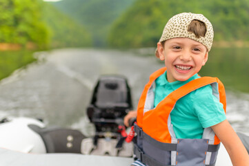 Little Boy Driving the Motorboat Wall mural