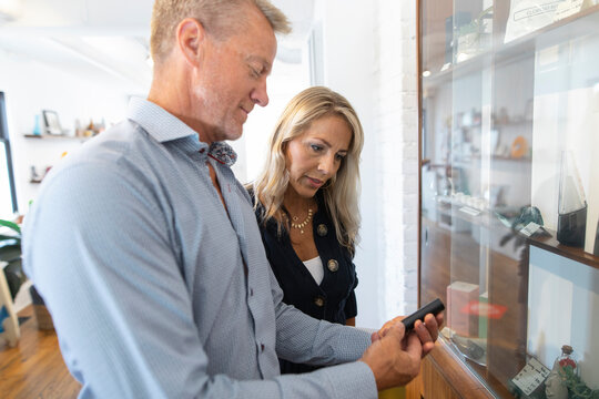 Couple looking at merchandise in marijuana dispensary