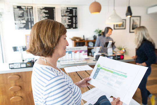 Woman reading information in marijuana dispensary