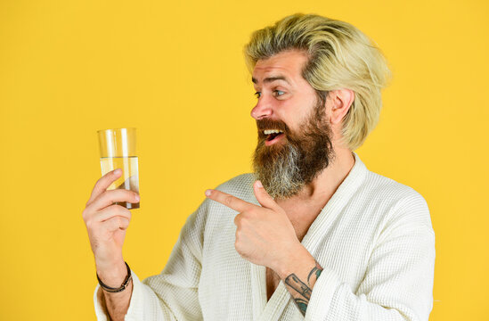 Balance your life. drink glass. moisturizing. stay hydrated with water. water balance in body. drink water during the day. hipster man in bathrobe. happy man with water glass