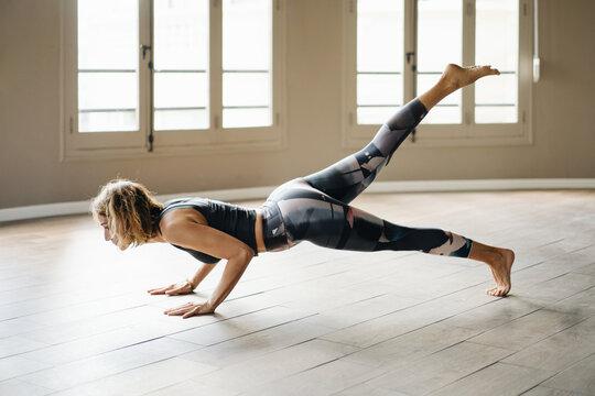 Woman performing during yoga training