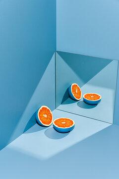Painted grapefruit near mirror