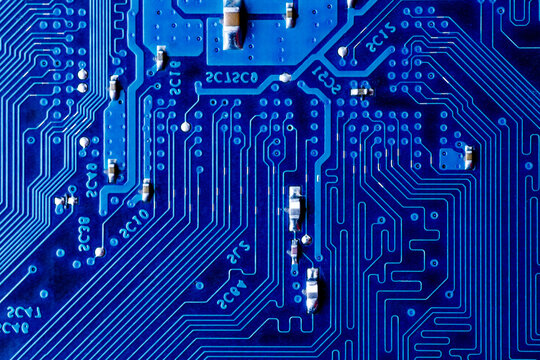 blue circuit board background of computer motherboard,Electronic computer hardware technology.Integrated communication processor. Information engineering component. Blue color.