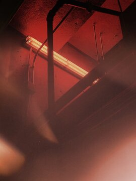 A stairwell with a red light at the top.