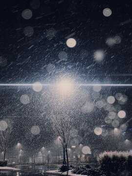 Snowy image of a street light