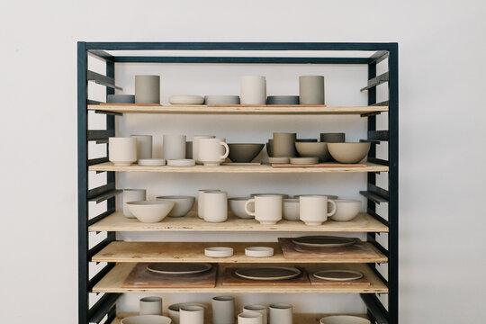 Crockery on shelf in workshop