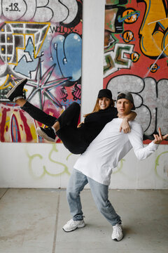 Girl amd boy making difficult dancing tricks.