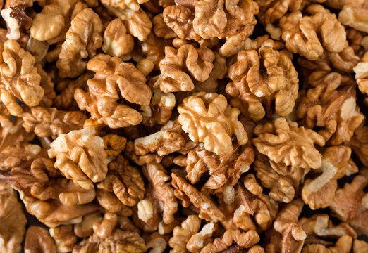 Peeled raw walnuts. Nuts background