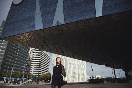 Young girl walking and enjoying city.
