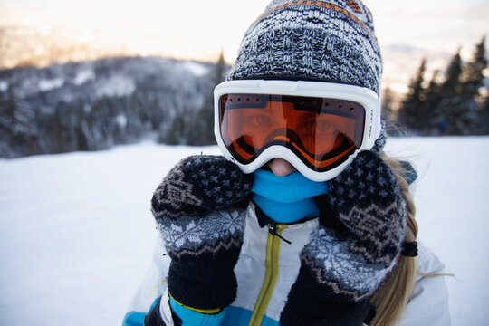 Woman in ski suit enjoying her vacation .