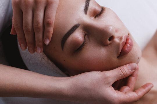 Facial massage at spa centre