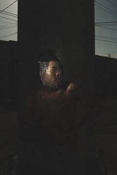 Dark Background Photo Of A Man Wearing A Face Mask