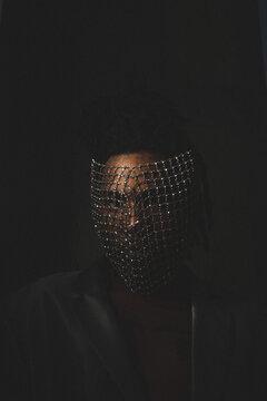 Black Man Wearing A Crystal Face Mask