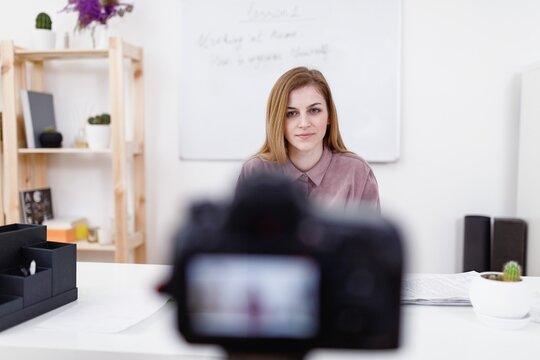 Blogger filming tasks for online course