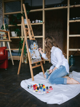Painter adding elements on her picture