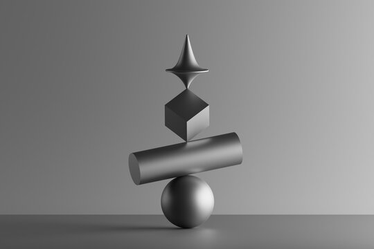 Three dimensional render of metallic top spinning on top of geometric cube, cylinder and sphere