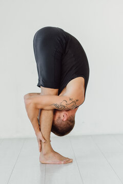 Hands to feet pose. Standing forward fold yoga pose.