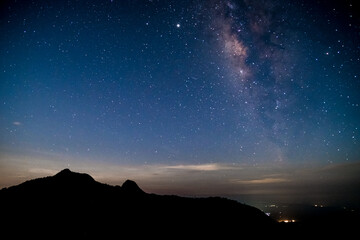 Obraz Amazing stary night above the mountain range in Doi Luang National Park, Thailand. - fototapety do salonu