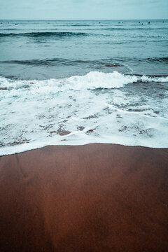 Beautiful beach landscape of the Basque Country Spain. Beach wave textures