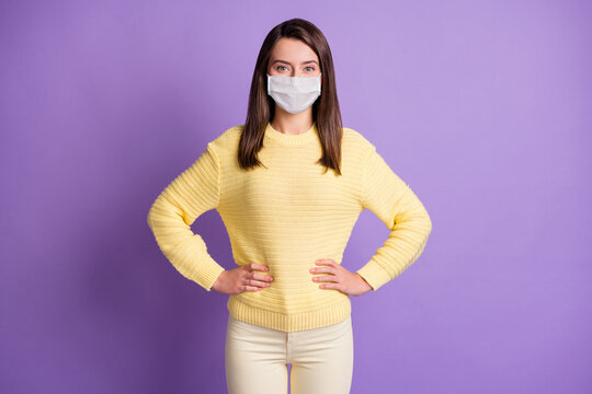 Photo portrait of young woman stand hands waist wear facial flu mask quarantine isolated purple colored background