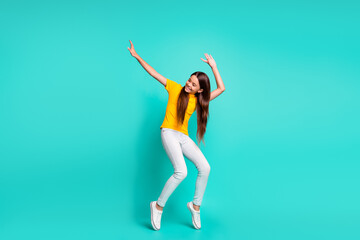 Full size photo of cool positive kid girl dancing isolated over teal color background