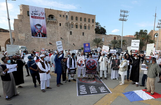 People gather to protest against the publications of a cartoon of Prophet Mohammad