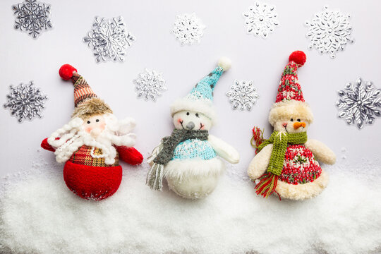 Happy holiday toys snowman and santa claus standing in winter christmas background. Christmas concept. Flat lay, top view.