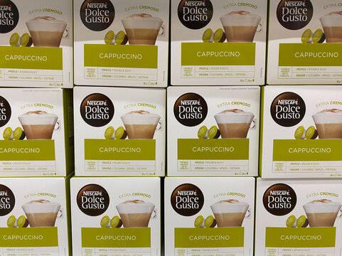 Viersen, Germany - July 9. 2020: View on isolated stack of boxes with Nescafe dolce gusto coffee cappucino capsules in german supermarket