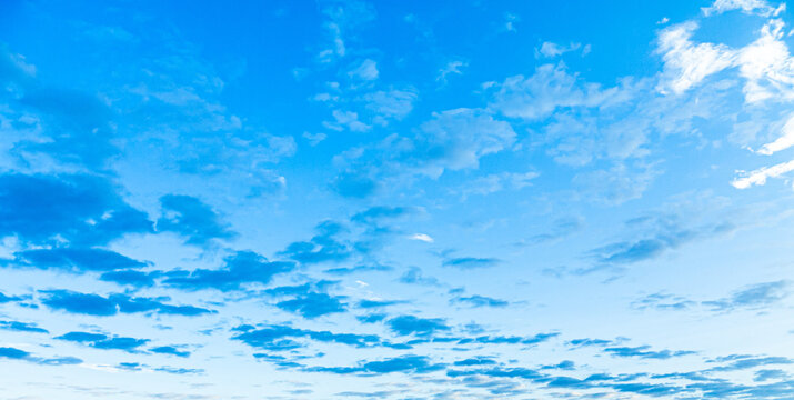 Blue morning sky with blue and white clouds