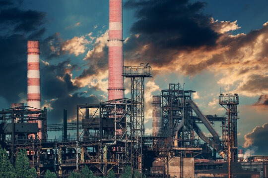 Petrochemical industrial factory of heavy industry, power refinery production with smoke pollution.