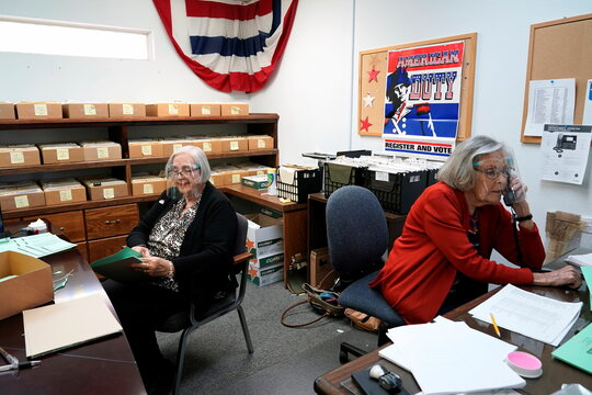 Judy James, left, organizes voter applications as Kay Pritchard, right, answers phone calls during early voting at the Creek County Election Board in Sapulpa