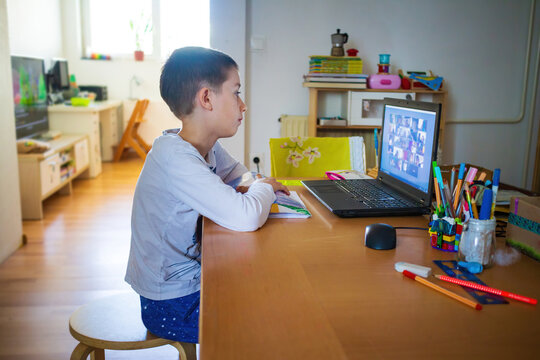 Child at home having remote school on laptop computer.
