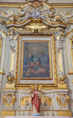 BOLOGNA, ITALY - MARCH 17, 2014: The altar and painting of Holy Trinity in baroque church Chiesa Corpus Christi by Marcantonio Franceschini (1648 - 1729).