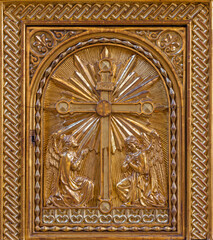 PRAGUE, CZECH REPUBLIC - OCTOBER 17, 2018: The carved polychrome tabernacle with the Annunciation relief in church kostel Svatého Cyrila Metodeje from end of 19. cent.