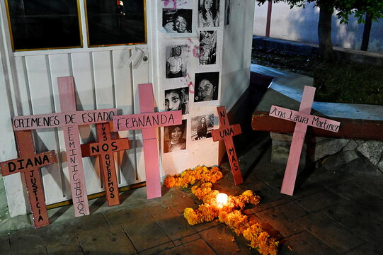 A cross made of Cempasuchil Marigold flowers and pink wooden crosses, bearing the names of victims of violence, are seen during a protest against femicide and violence against women in the country, in Chimalhuacan