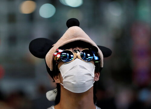 A reveller wearing a protective face mask and a costume walks on the Shibuya crossing during Halloween, amid the coronavirus disease (COVID-19) outbreak, in Tokyo
