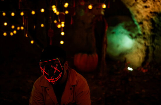 A visitor wears a mask during an event marking Halloween at an amusement park in Beijing
