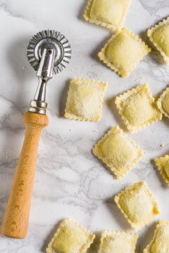 Ravioli, and a pastry cutter wheel on the table. Top View