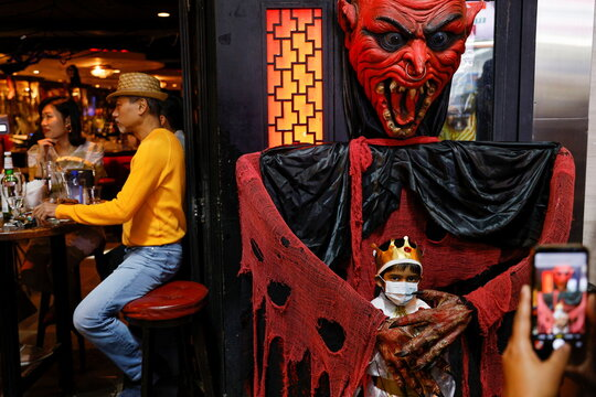 A child wears a protective mask celebrating Halloween at Lan Kwai Fong, a popular nightlife destination in Central, following the coronavirus disease (COVID-19) outbreak, in Hong Kong